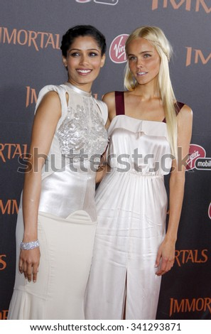 "LOS ANGELES, CALIFORNIA - November 7, 2011. Freida Pinto and Isabel Lucas at the World premiere of ""Immortals"" held at Nokia LA Live, Los Angeles."