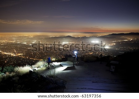 LOS ANGELES, CALIFORNIA - OCTOBER 12: Night time bike riders risk life and limb to reach breath taking night views on top of 3200' Echo Mountain on October 12, 2010 in Los Angeles, California. - stock photo