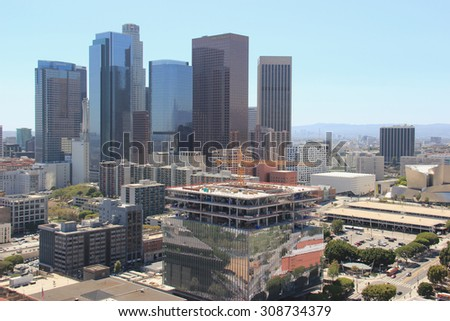Los Angeles, California, USA - August 14, 2015: Downtown Los Angeles is composed of different areas from a fashion district to a skid row, and it is the hub of the city's Metro rapid transit system.