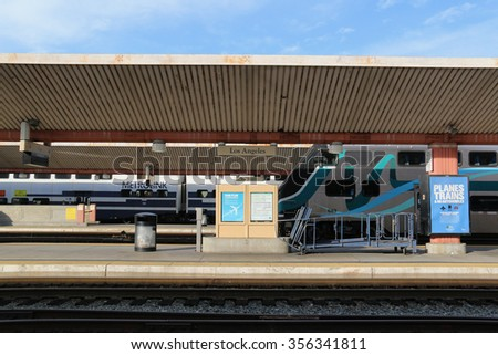 """Los Angeles, California, USA - December 21, 2015: LA Union Station, known as the """"Last of the Great Railway Stations"""" built in the US, is the largest railroad passenger terminal in the Western USA. - stock photo"""