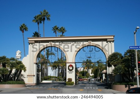 Los Angeles, California, USA - December 6, 2010: Main entry gate, 'Melrose Gate', to the Paramount Pictures studio lot on Melrose Avenue, Hollywood, Los Angeles, California, USA - stock photo