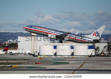 LOS ANGELES, CALIFORNIA, USA - JANUARY 28, 2013 - American Airlines Boeing 737-823 takes off from Los Angeles Airport on January 28, 2013. The plane seats 126 passengers with a range of 10,200 km - stock photo