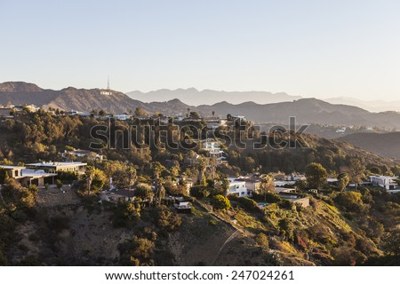 LOS ANGELES, CALIFORNIA, USA - January 1, 2015:  Hollywood Hills, homes and sign in the Santa Monica Mountains above Los Angeles. - stock photo