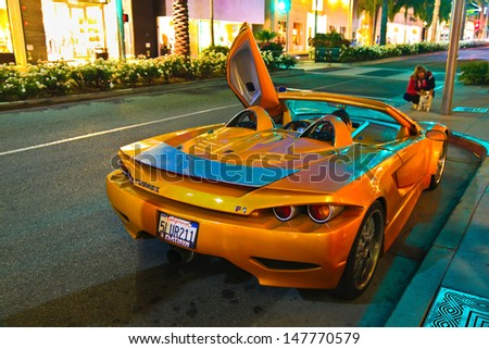 LOS ANGELES, CALIFORNIA, USA - JULY 27, 2013 : Luxurious Slovenian sports supercar Tushek stops on Rodeo Drive in Beverly Hills, California on July 27, 2013. Tushek is the Slovenia supercar builder. - stock photo