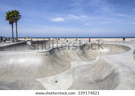 LOS ANGELES, CALIFORNIA , USA - June 20, 2014:  Concrete ramps and ocean views at the popular Venice beach skateboard park in Los Angeles, California. - stock photo