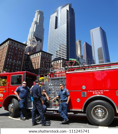 LOS ANGELES, CALIFORNIA, USA - JUNE 10, 2012: Unidentified Los Angeles firefighters wait for a new assignment in LA downtown on June 10, 2012 in Los Angeles, California - stock photo