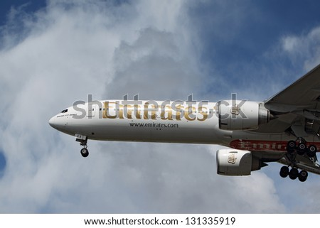 LOS ANGELES, CALIFORNIA, USA - MARCH 8, : Emirates Boeing 777-31HER lands at Los Angeles Airport on March 8, 2013. The plane has the most powerful jet engines in commercial service