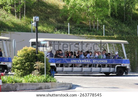 Los Angeles, California, USA - March 12, 2015: Studio Tour Tram is taking tourists to visit the studios used in many Hollywood movies at Universal Studios Hollywood. - stock photo