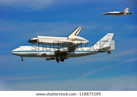 LOS ANGELES, CALIFORNIA, USA - SEPTEMBER 21: Space Shuttle Endeavour makes dramatic final flight around Los Angeles Downtown on September 21, 2012 in Los Angeles, California - stock photo