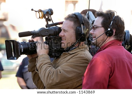 Los Angeles camera man with video gear. - stock photo