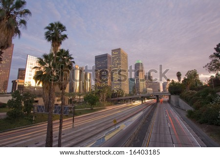 Los Angeles city and highway at sunset - stock photo