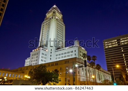 Los Angeles City Hall at nighttime shot from ground level. with other Civic Center building framing the shot. - stock photo