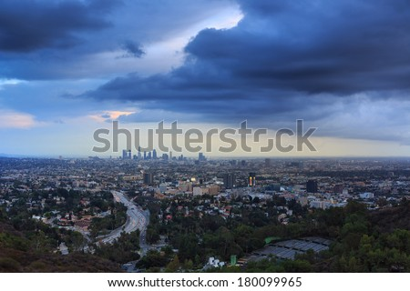 Los Angeles city skyline cityscape with beautiful storm clouds sky background. - stock photo