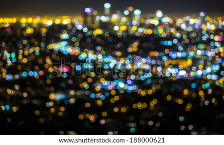 Los Angeles cityscape at night with lights blurred into bokeh circles background. - stock photo