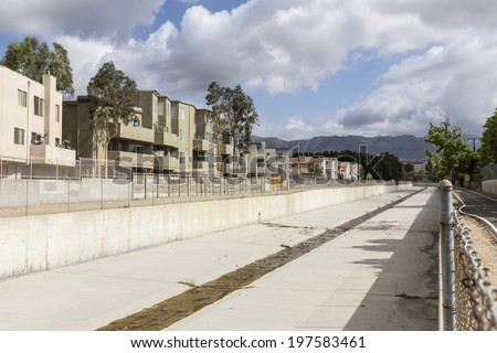 Los Angeles County flood control channel in the northwest San Fernando Valley area of the City of Los Angeles.   - stock photo
