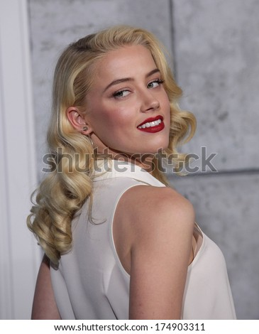 "LOS ANGELES - DEC 06:  AMBER HEARD arrives to the ""Sherlock Holmes A Game of Shadows"" Los Angeles Premiere  on December 06, 2011 in Westwood, CA                 - stock photo"