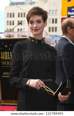 LOS ANGELES - DEC 13:  Anne Hathaway at the Hollywood Walk of Fame ceremony for Hugh Jackman at Hollywood Boulevard on December 13, 2012 in Los Angeles, CA - stock photo