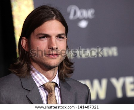 "LOS ANGELES - DEC 05:  ASHTON KUTCHER arriving to ""New Year's Eve"" World Premiere  on December 5, 2011 in Hollywood, CA - stock photo"
