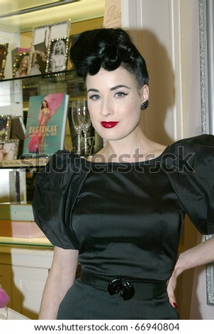 "LOS ANGELES - DEC. 9: Dita Von Teese and Cointreau celebrate the launch of ""My Private Cointreau Coffret"" at Ron Robinson/Fred Segal on December 9, 2010 in Los Angeles, CA."