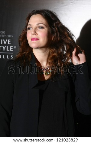 LOS ANGELES - DEC 5:  Drew Barrymore arrives to the Rodeo Drive Walk Of Style Honoring BLVGARI at Rodeo Drive on December 5, 2012 in Beverly Hills, CA - stock photo