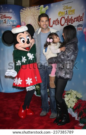 """LOS ANGELES - DEC 11:  Eric Winter, Sebella Winter, Roselyn Sanchez, Minnie Mouse at the """"Disney on Ice"""" Red Carpet Reception at the Staples Center on December 11, 2014 in Los Angeles, CA - stock photo"""