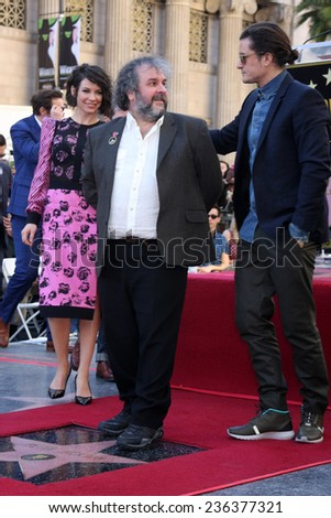 LOS ANGELES - DEC 8:  Evangeline Lilly, Sir Peter Jackson, Orlando Bloom at the Peter Jackson Hollywood Walk of Fame Ceremony at the Dolby Theater on December 8, 2014 in Los Angeles, CA - stock photo