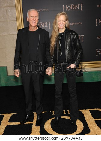 "LOS ANGELES - DEC 09:  James Cameron & Suzy Amis arrives to the ""The Hobbit: The Battle Of The Five Armies"" Los Angeles Premiere  on December 9, 2014 in Hollywood, CA                 - stock photo"