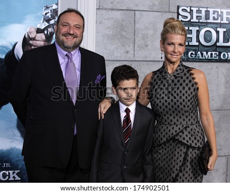 "LOS ANGELES - DEC 06:  JOEL SILVER & FAMILY arrives to the ""Sherlock Holmes A Game of Shadows"" Los Angeles Premiere  on December 06, 2011 in Westwood, CA                 - stock photo"