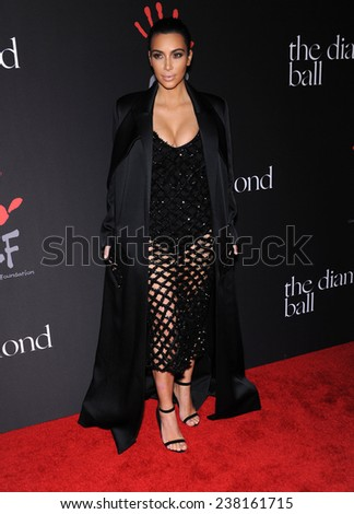 LOS ANGELES - DEC 11:  Kim Kardashian arrives to the The First Annual Diamond Ball on December 11, 2014 in Beverly Hills, CA                 - stock photo