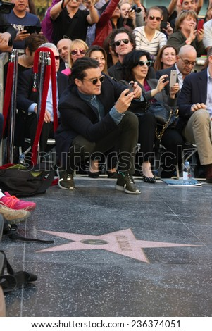 LOS ANGELES - DEC 8:  Orlando Bloom at the Peter Jackson Hollywood Walk of Fame Ceremony at the Dolby Theater on December 8, 2014 in Los Angeles, CA - stock photo