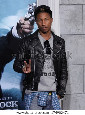 "LOS ANGELES - DEC 06:  PHARRELL WILLIAMS arrives to the ""Sherlock Holmes A Game of Shadows"" Los Angeles Premiere  on December 06, 2011 in Westwood, CA                 - stock photo"