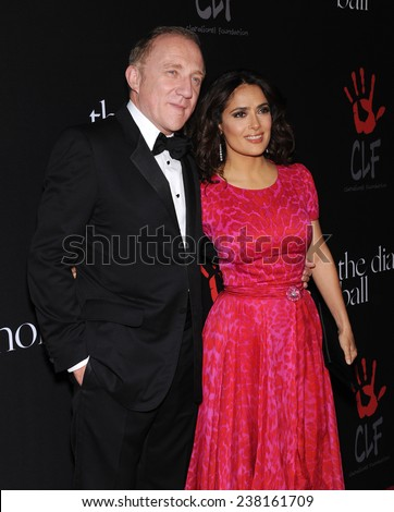 LOS ANGELES - DEC 11:  Salma Hayek & Francois-Henri Pinault arrives to the The First Annual Diamond Ball on December 11, 2014 in Beverly Hills, CA                 - stock photo