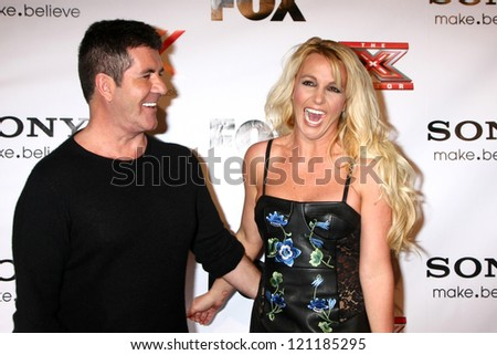 LOS ANGELES - DEC 6:  Simon Cowell, Britney Spears arrives to the X Factor 2012 Final Four Party at Rodeo Drive on December 6, 2012 in Beverly Hills, CA - stock photo