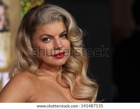 "LOS ANGELES - DEC 05:  STACEY 'Fergie' FEREGUSON arriving to ""New Year's Eve"" World Premiere  on December 5, 2011 in Hollywood, CA - stock photo"