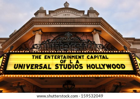 Los Angeles - Dec 26, 2009: Universal Studios, the entrance of a vintage movie theater in Hollywood with signs on neon lights - stock photo