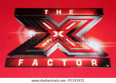 "LOS ANGELES - DEC 19:  X Factor Logo at the FOX's ""The X Factor"" Press Conference  at CBS Studios on December 19, 2011 in Los Angeles, CA - stock photo"