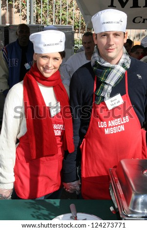 LOS ANGELES - DECEMBER 22: Jennifer Love Hewitt and Ross McCall at the Annual Los Angeles Mission Christmas Event December 22, 2006 in Los Angeles, CA. - stock photo
