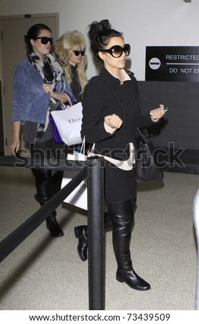 LOS ANGELES - DECEMBER 17: Kim and Khloe Kardashian are seen at LAX airport. December 17th 2010 in Los Angeles, California - stock photo