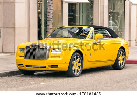 LOS ANGELES - DECEMBER 18, 2013: Rolls Royce Phantom Drophead parked on Rodeo Drive. Since 2010 Rolls Royce has a partnership with the world famous Beverly Hills based designer Bijan Pakzad. - stock photo