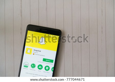 Los Angeles, december 15, 2017: Smartphone with Snapchat application in google play store on wooden background