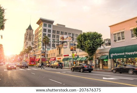 LOS ANGELES - DECEMBER 18, 2013: View of Hollywood Boulevard at sunset. In 1958, the Hollywood Walk of Fame was created on this street as a tribute to artists working in the entertainment industry - stock photo