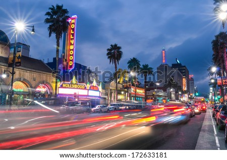 LOS ANGELES - DECEMBER 18, 2013: View of Hollywood Boulevard by night. In 1958, the Hollywood Walk of Fame was created on this street as a tribute to artists working in the entertainment industry. - stock photo