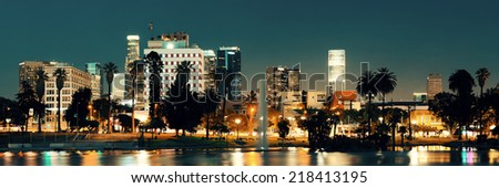 Los Angeles downtown at night with urban buildings and lake - stock photo