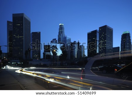 Los Angeles downtown skyline and streets with fast moving cars