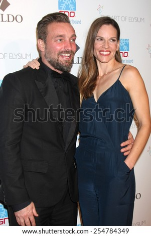"""LOS ANGELES - FEB 19:  Brian Bowen Smith, Hilary Swank at the """"Icons of the Awards"""" Pre-Oscar Party at a Mr C Beverly Hills on February 19, 2015 in Beverly Hills, CA - stock photo"""