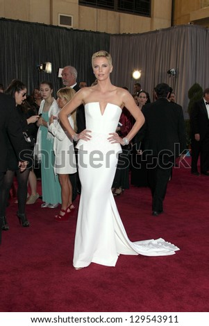 LOS ANGELES - FEB 24:  Charlize Theron arrives at the 85th Academy Awards presenting the Oscars at the Dolby Theater on February 24, 2013 in Los Angeles, CA - stock photo