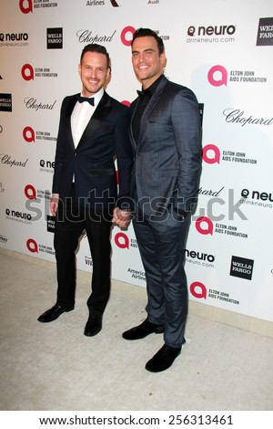 LOS ANGELES - FEB 22:  Cheyenne Jackson, Jason Landau at the Elton John Oscar Party 2015 at the City Of West Hollywood Park on February 22, 2015 in West Hollywood, CA - stock photo