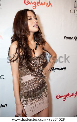 "LOS ANGELES - FEB. 12: Christian Serratos attends the ""Fame At The Mansion"" 2012 Grammy Aterparty hosted by Sean ""Diddy"" Combs held at the Playboy Mansion. Los Angeles, Feb 12, 2012 - stock photo"