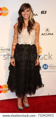 LOS ANGELES - FEB 11:  Christina Perri arrives at the Muiscares Gala Honoring Barbra Streisand at Convention Center on February 11, 2011 in Los Angeles, CA - stock photo