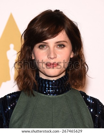 LOS ANGELES - FEB 02:  Felicity Jones arrives to the Oscar Nominee Reception  on February 2, 2015 in Beverly Hills, CA                 - stock photo